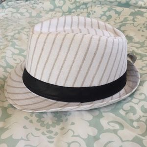 White and black with siver pinstripe fedora.